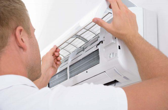 Man Adjusting Air Conditioning System